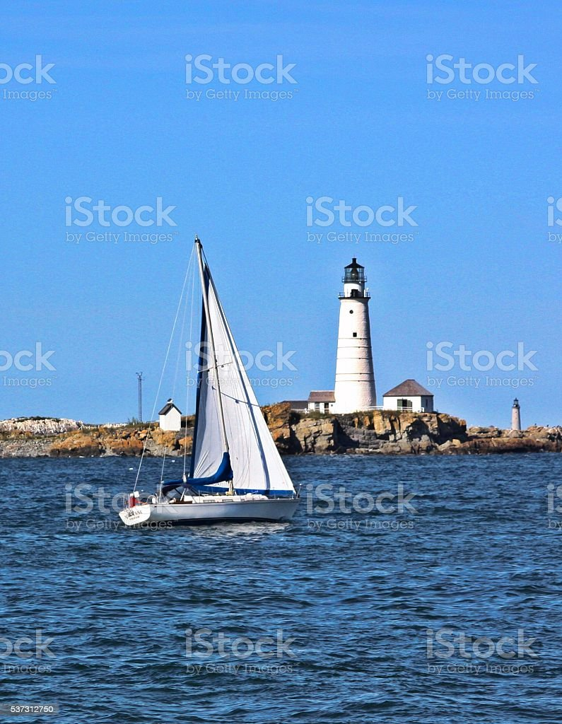 Sailing By Old Boston Lighthouse stock photo