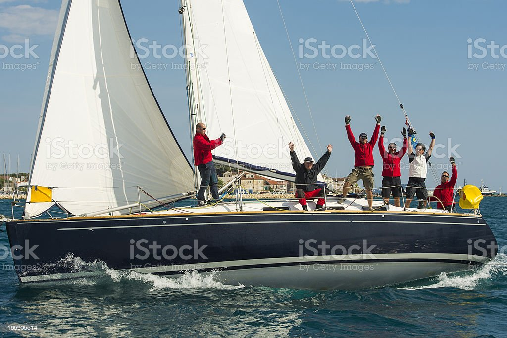 Sailing crew celebrating the victory stock photo