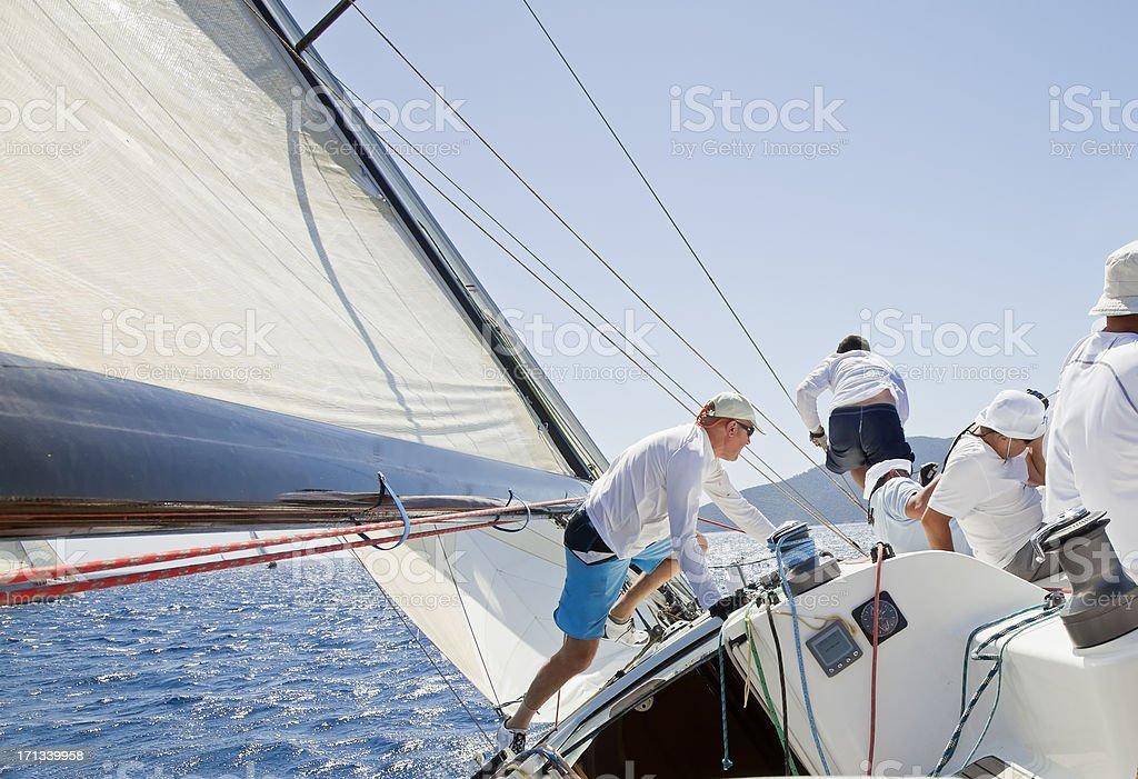 Sailing crew members at race stock photo