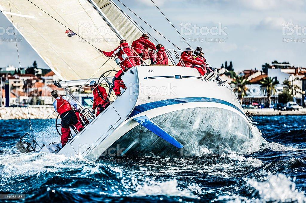 Sailing crew on sailboat during regatta royalty-free stock photo