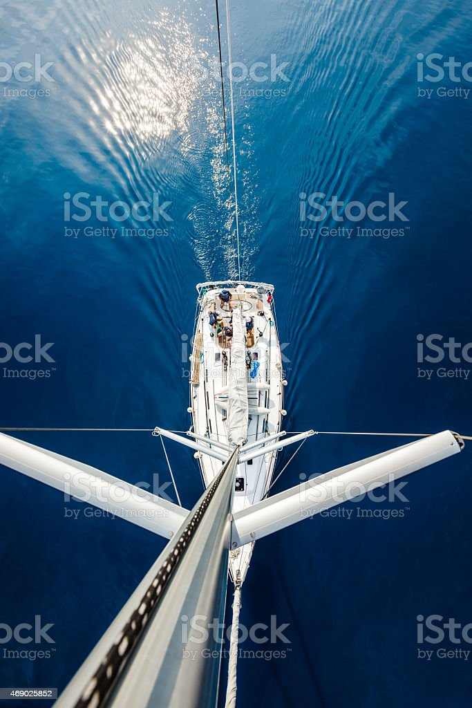 Sailing crew on sailboat, view from above stock photo