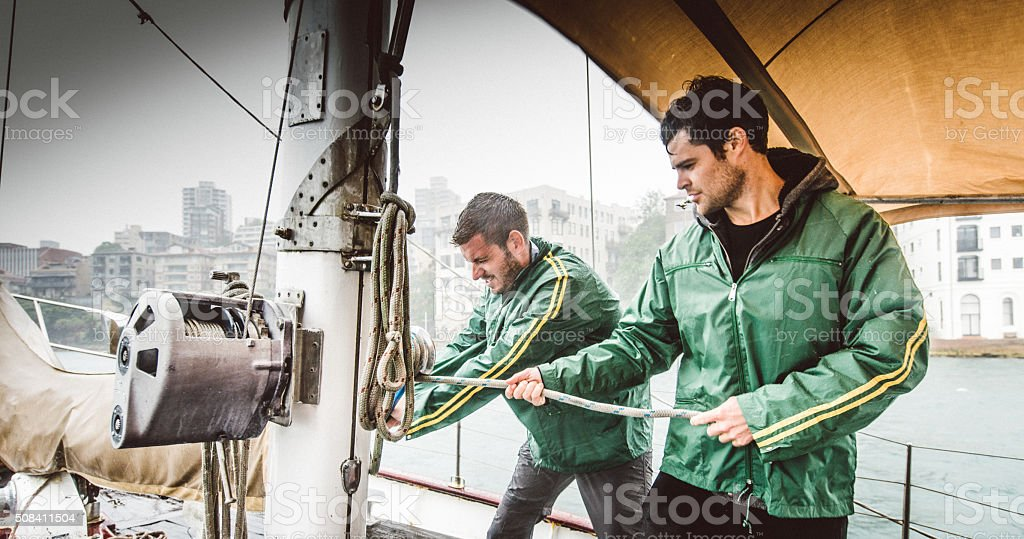 Sailing crew winding winch sydney Australia stock photo