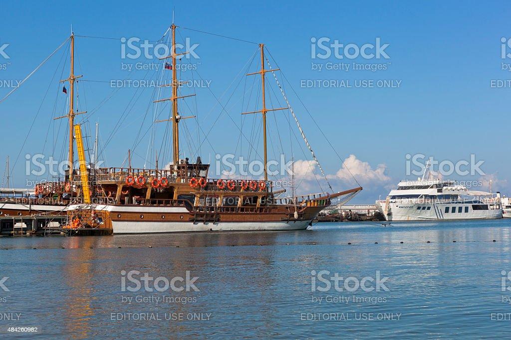 Sailing Gloria and motor ship Empire at pier in Gelendzhik stock photo