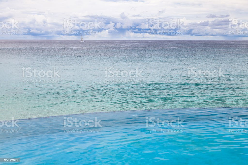 Sailing in Long Bay St Martin on a cloudy day stock photo