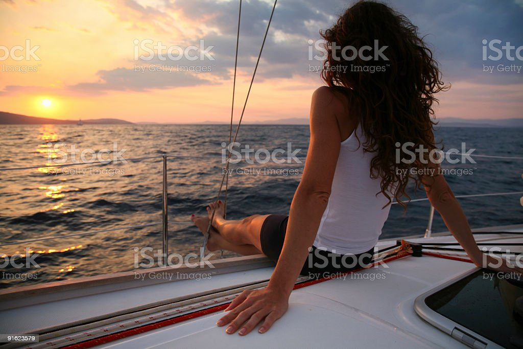 Sailing in sunset royalty-free stock photo