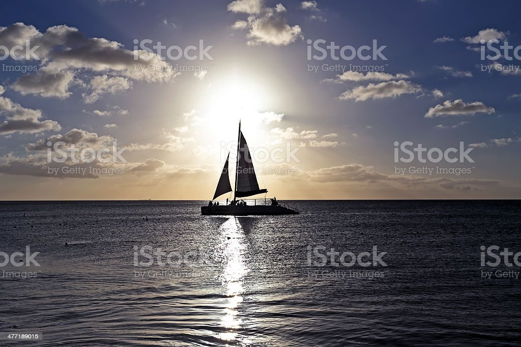 Sailing in the caribbean at sunset stock photo