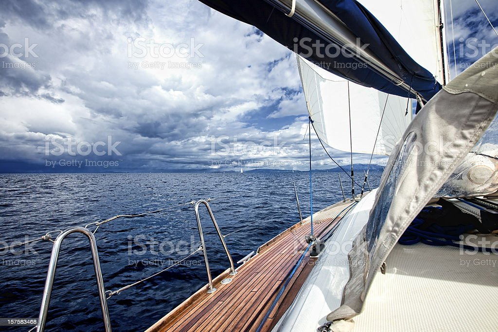 Sailing in the wind on sailboat stock photo