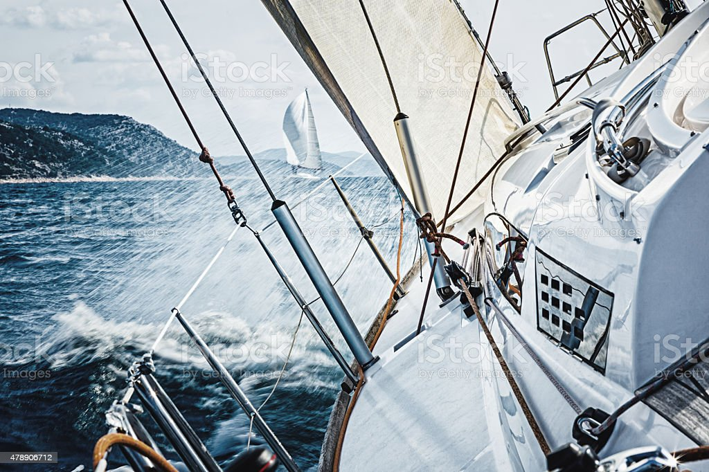Sailing in the wind with sailboat stock photo