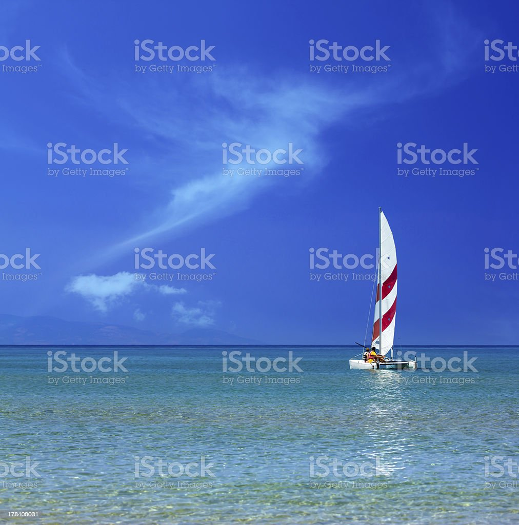 Sailing in turquoise sea royalty-free stock photo