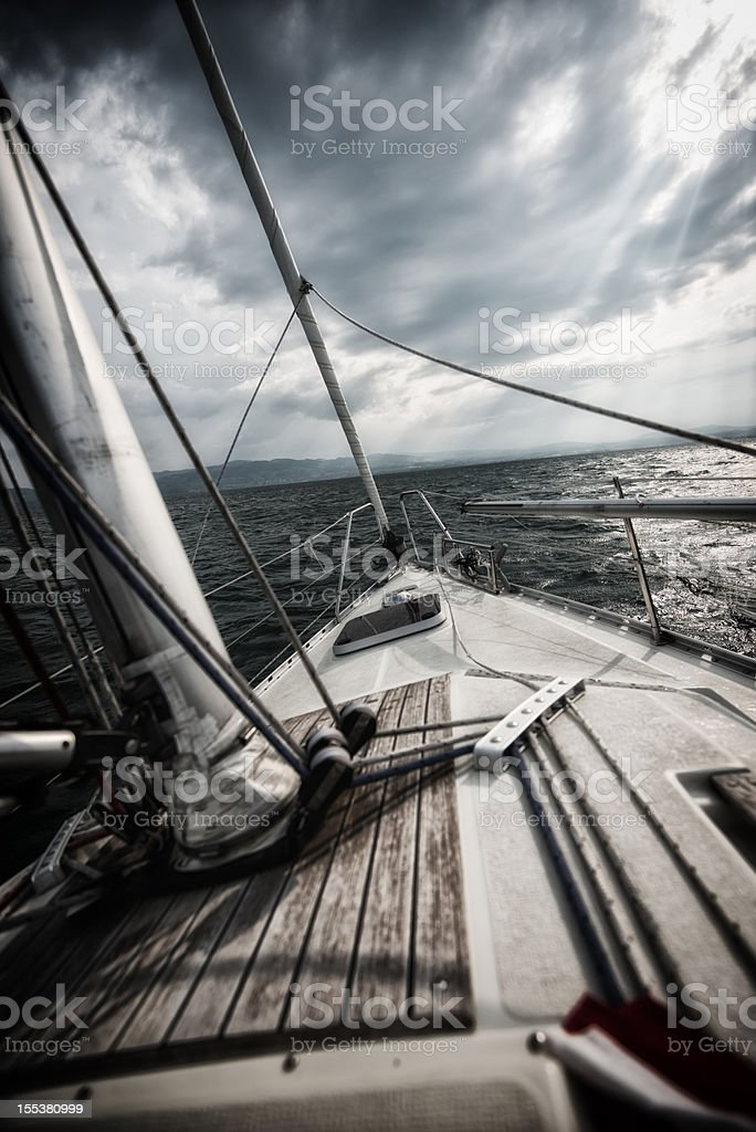 sailing into a storm stock photo