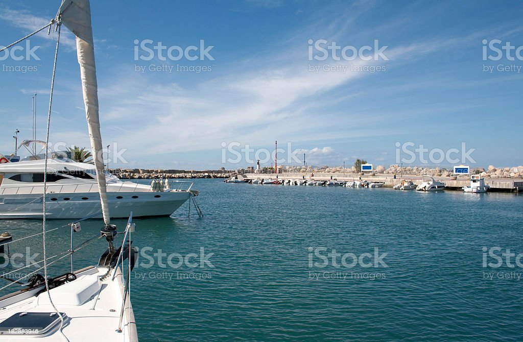 sailing into harbour in sicily royalty-free stock photo