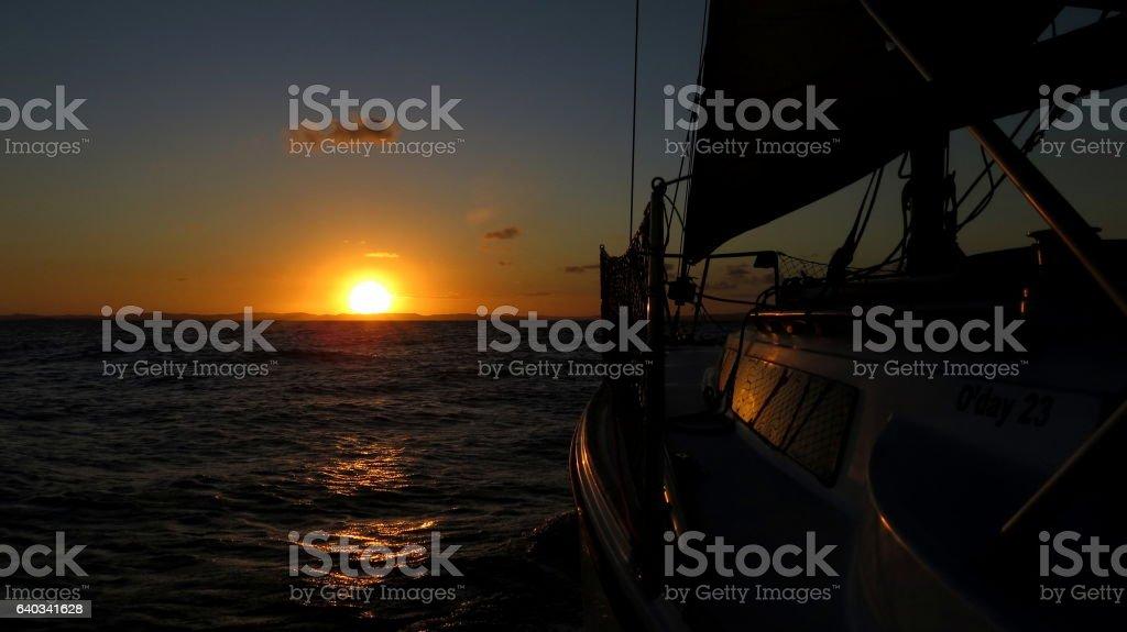 Sailing into the sun stock photo