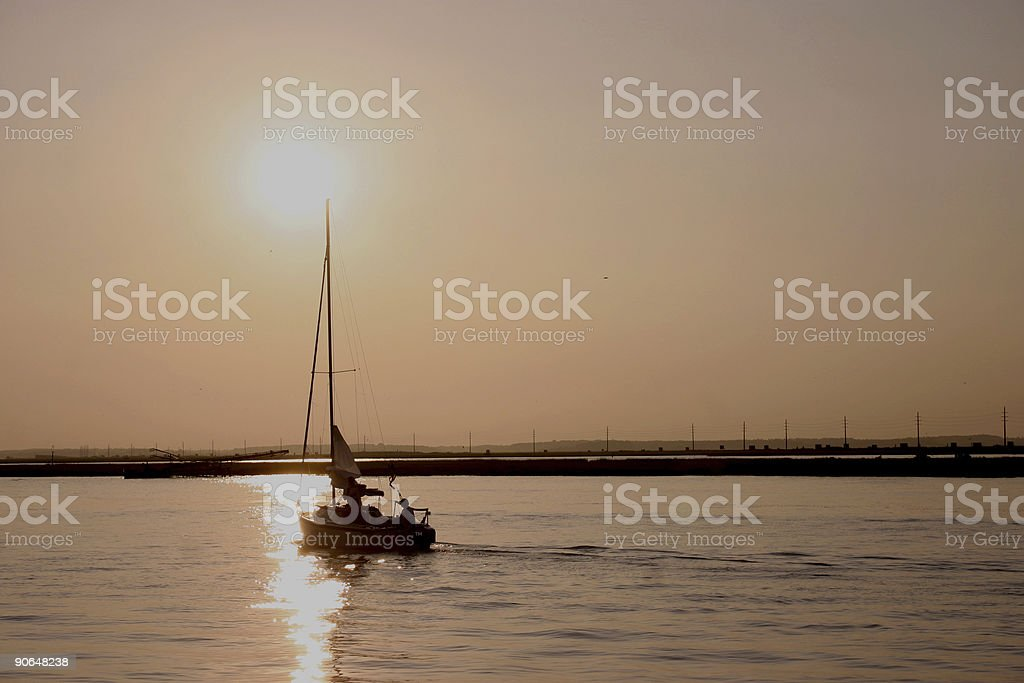 Sailing into the sunset stock photo