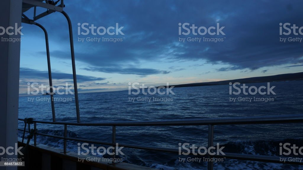 sailing north sea with sunrise in husavik(iceland) stock photo