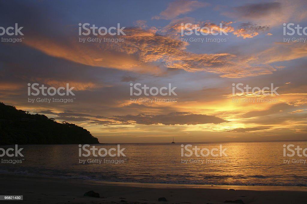 Sailing off into the sunset royalty-free stock photo