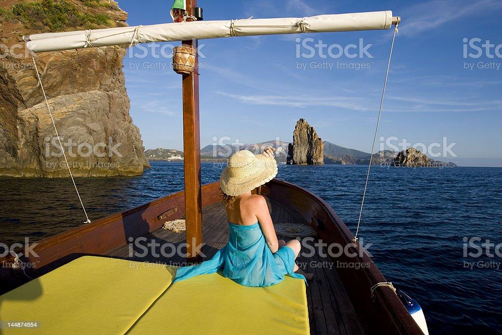sailing off the coast of vulcano stock photo
