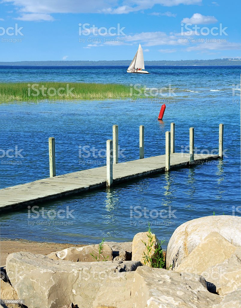Sailing on blue water stock photo