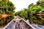 Sailing on Indigenous wooden canoe in the Amazon state Venezuela