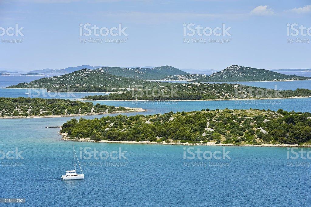 Sailing on sailboat with island in Croatia stock photo