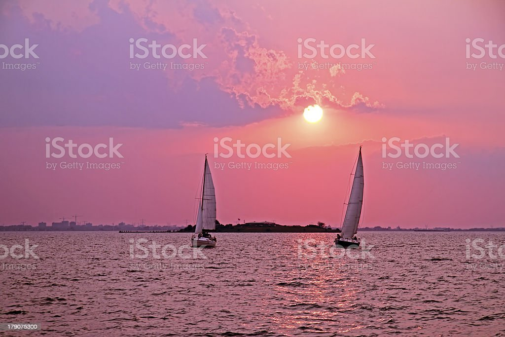 Sailing on the IJsselmeer in Netherlands at sunset royalty-free stock photo