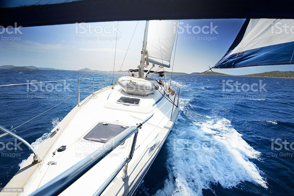 sailing on Yacht at sunny day stock photo
