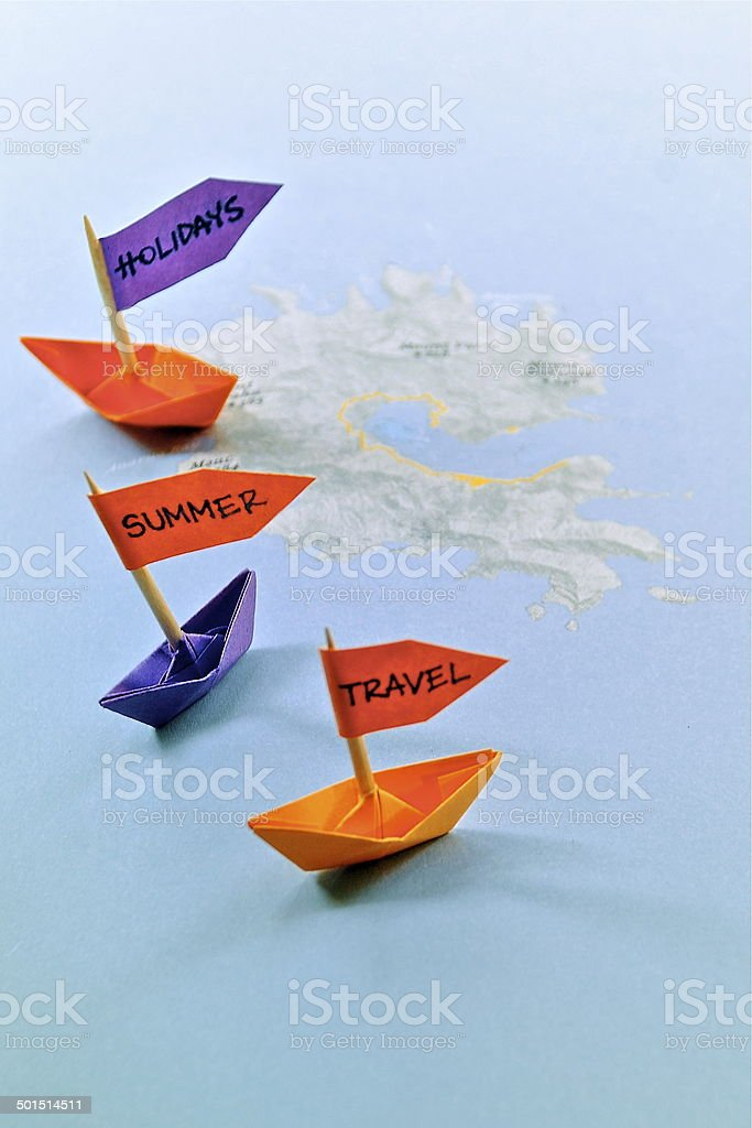 Sailing Paper Boats on a Map stock photo