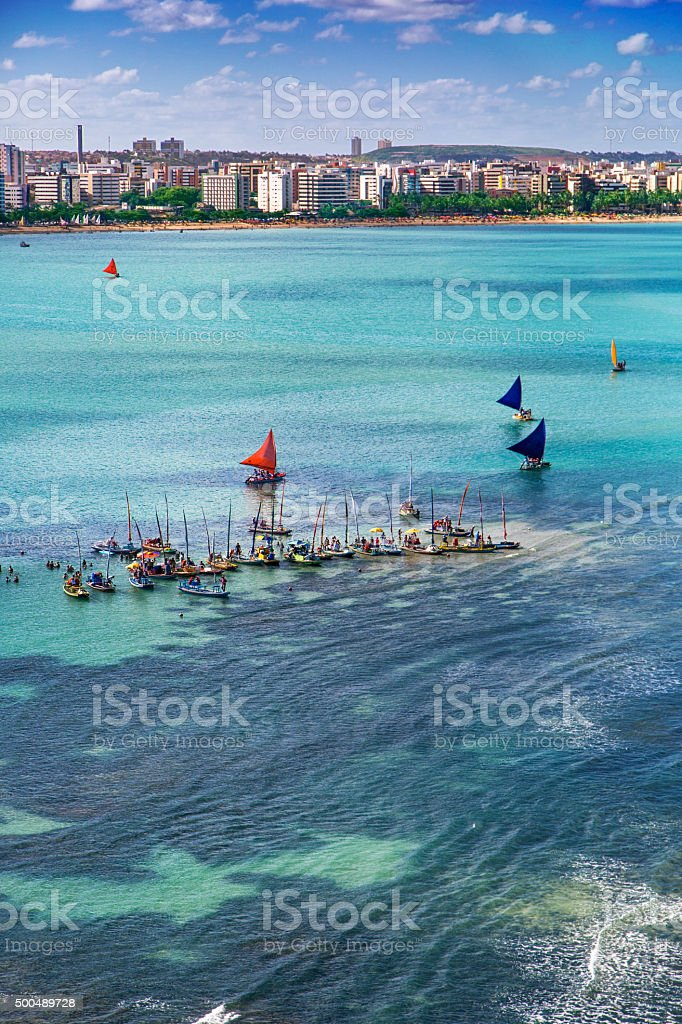 Sailing rafts and sunbathers in Maceio stock photo