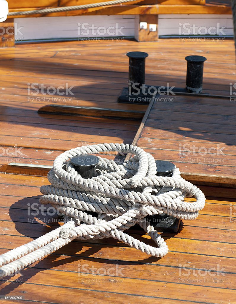 Sailing Rope in a wooden boat royalty-free stock photo