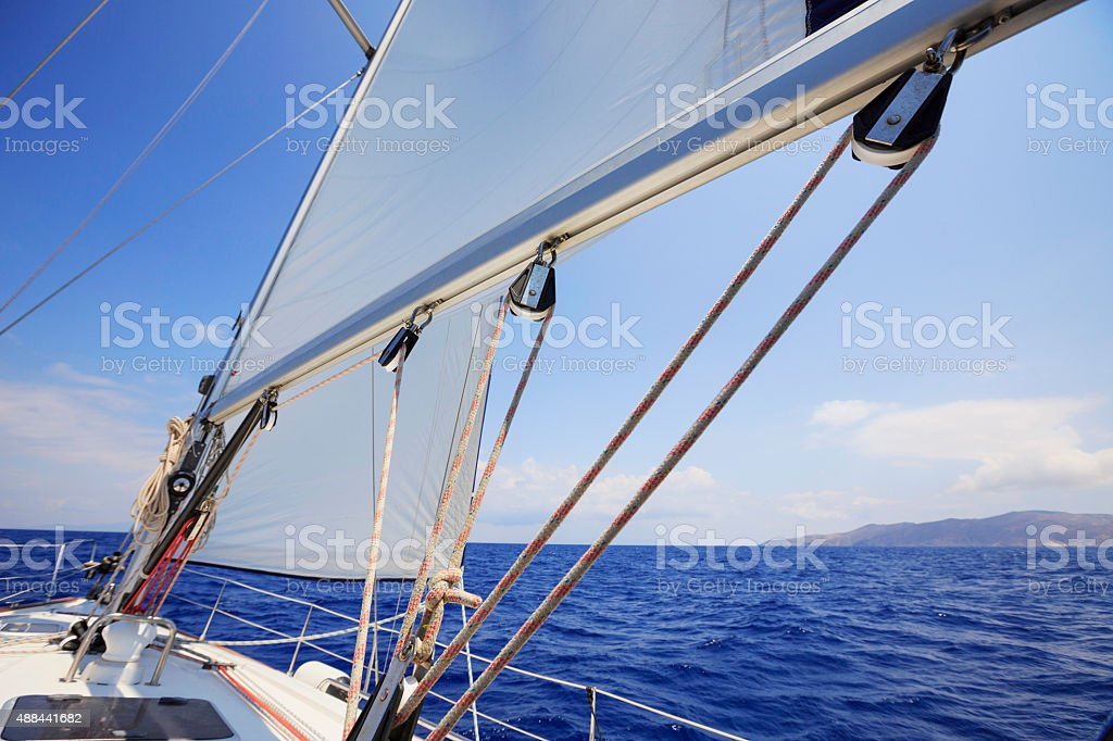 Sailing  Sails and winch of sailboat  Beautiful sea in background stock photo