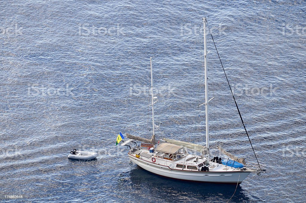 sailing ship afloat in calm waters stock photo