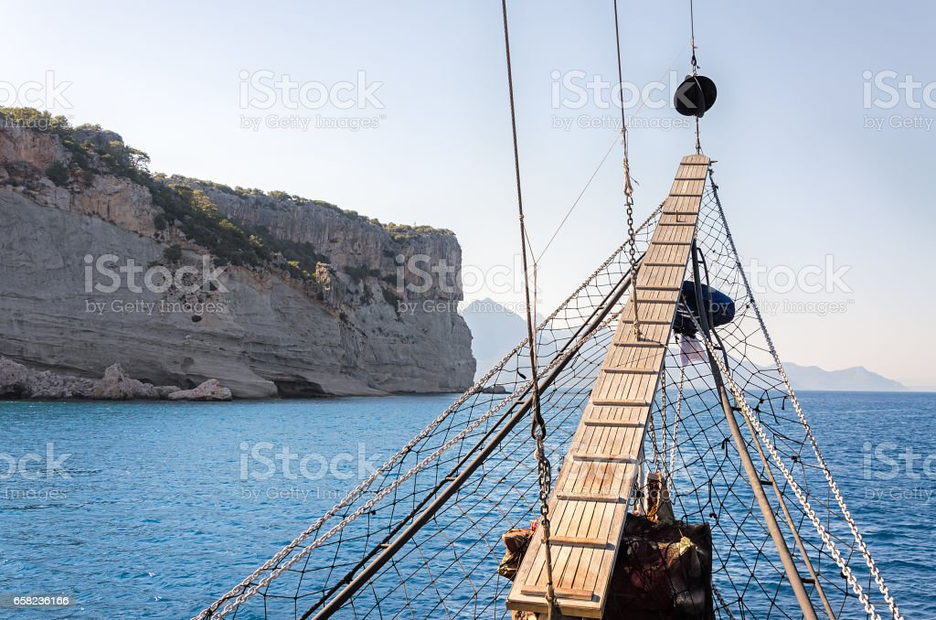 Sailing ship against the backdrop of the mountains stock photo
