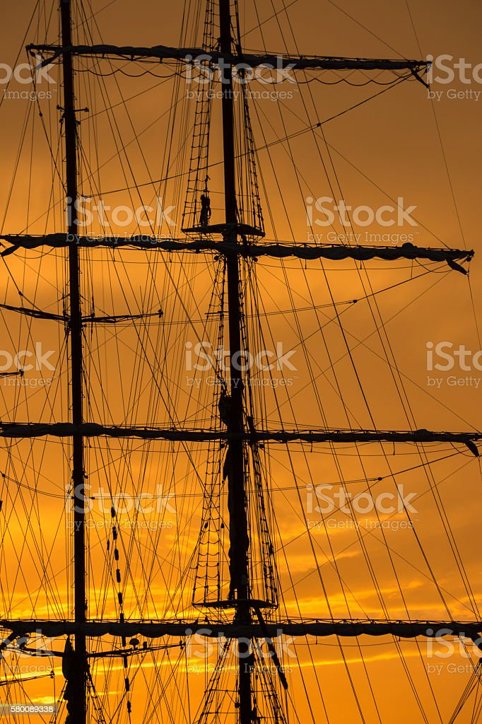 sailing ship at sunset stock photo
