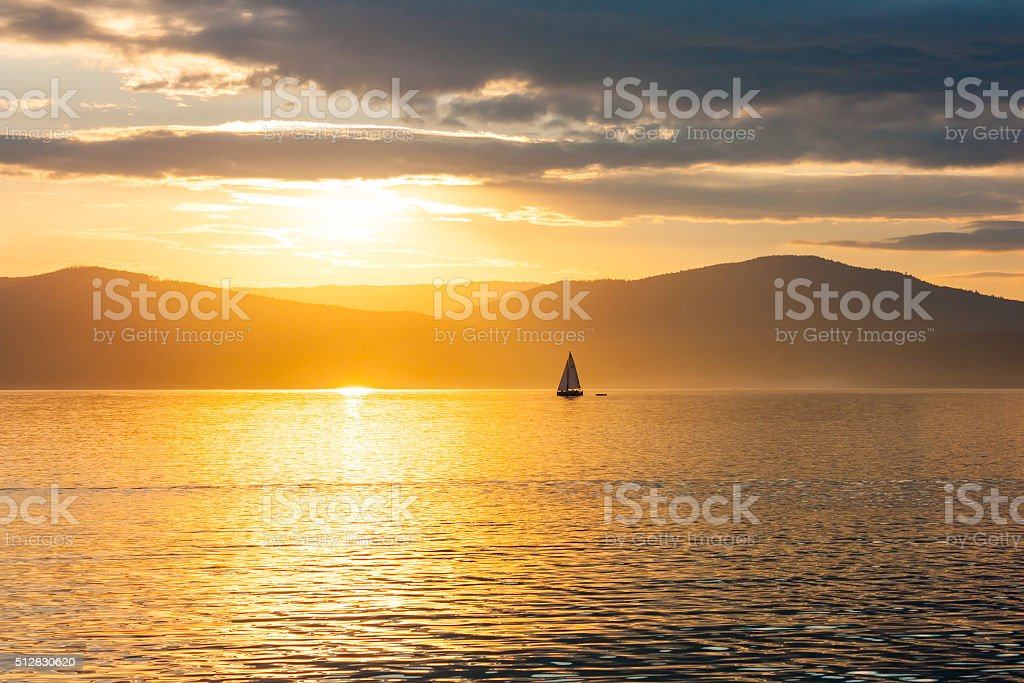 Sailing ship on the lake at sunset skyline royalty-free stock photo