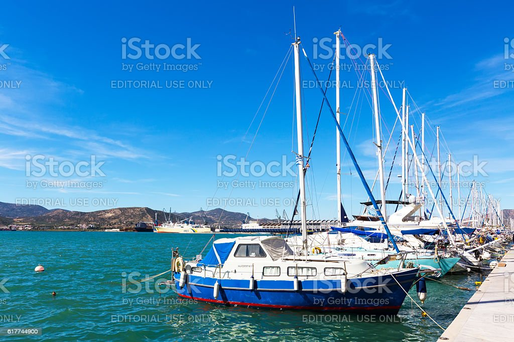 Sailing ships and yachts moored in the port of Volos stock photo