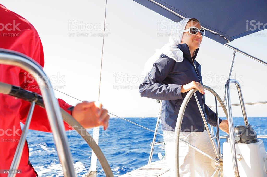 Sailing Skipper at the wheel of a yacht stock photo