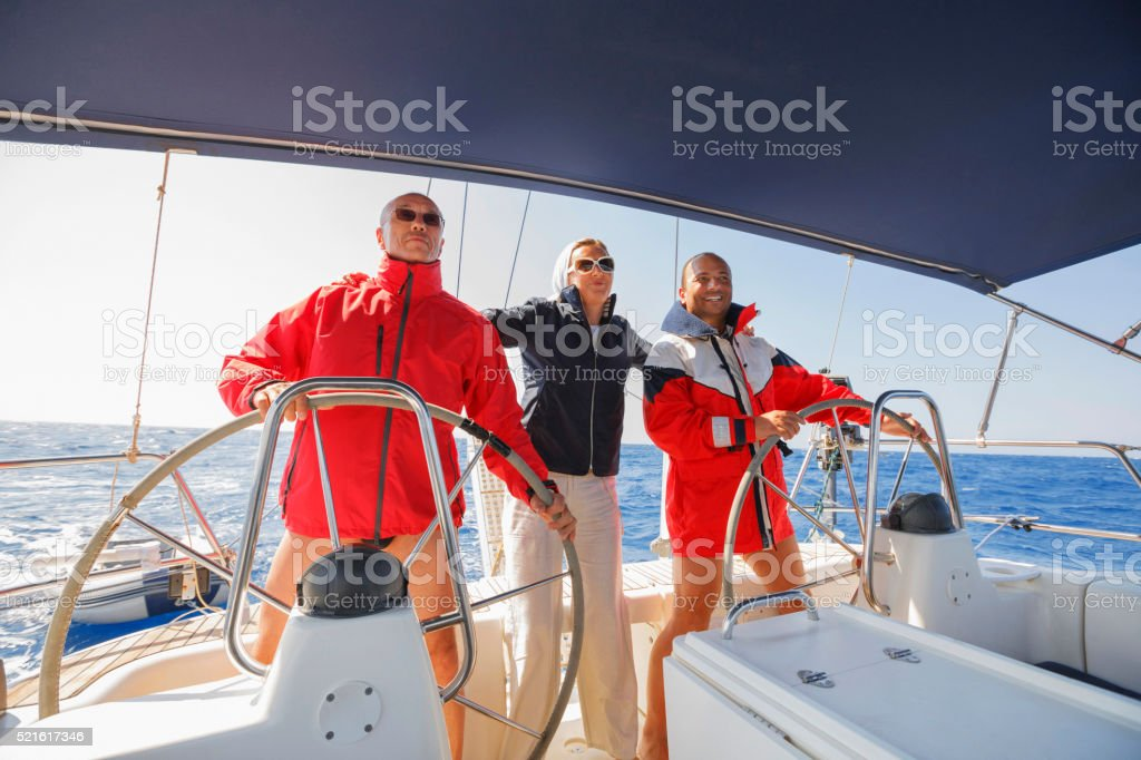 Sailing Skipper at the wheel of a yacht stock photo