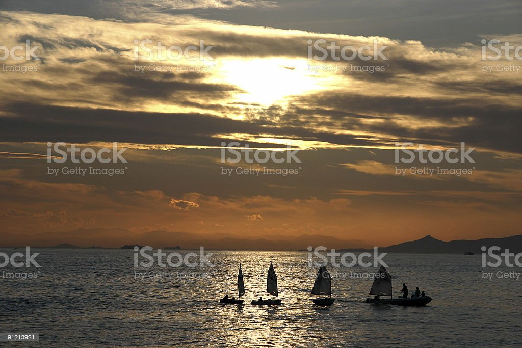 Sailing sunset in Athens by the sea. royalty-free stock photo