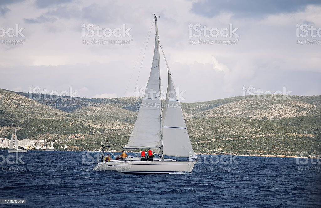 Sailing team on yacht and stormy weather stock photo