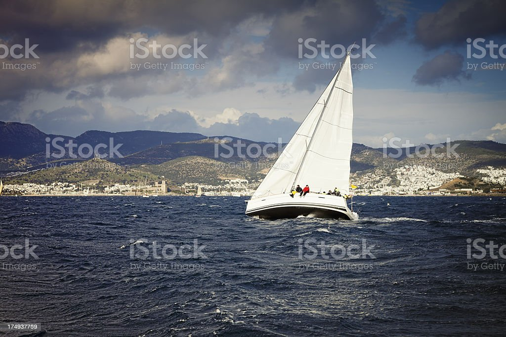 Sailing team on yacht and stormy weather royalty-free stock photo