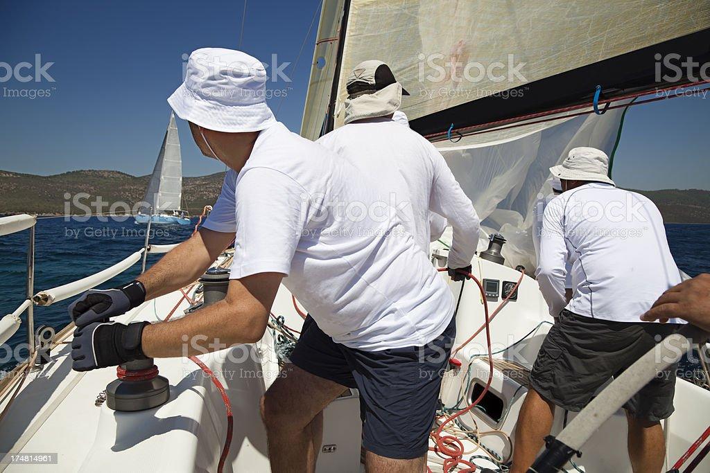 Sailing team on yacht royalty-free stock photo