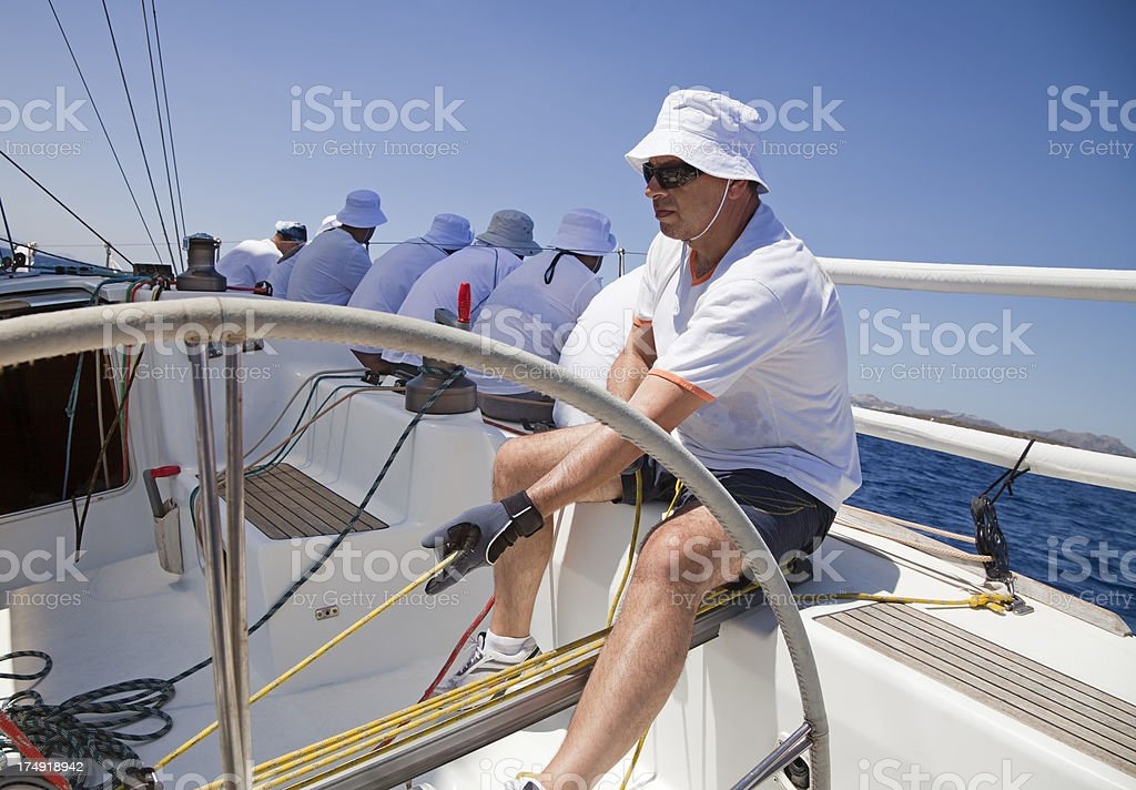 Sailing team on yacht royalty-free stock photo