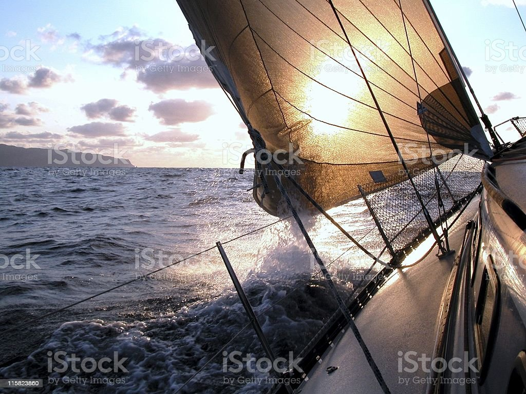 sailing to the sunrise royalty-free stock photo