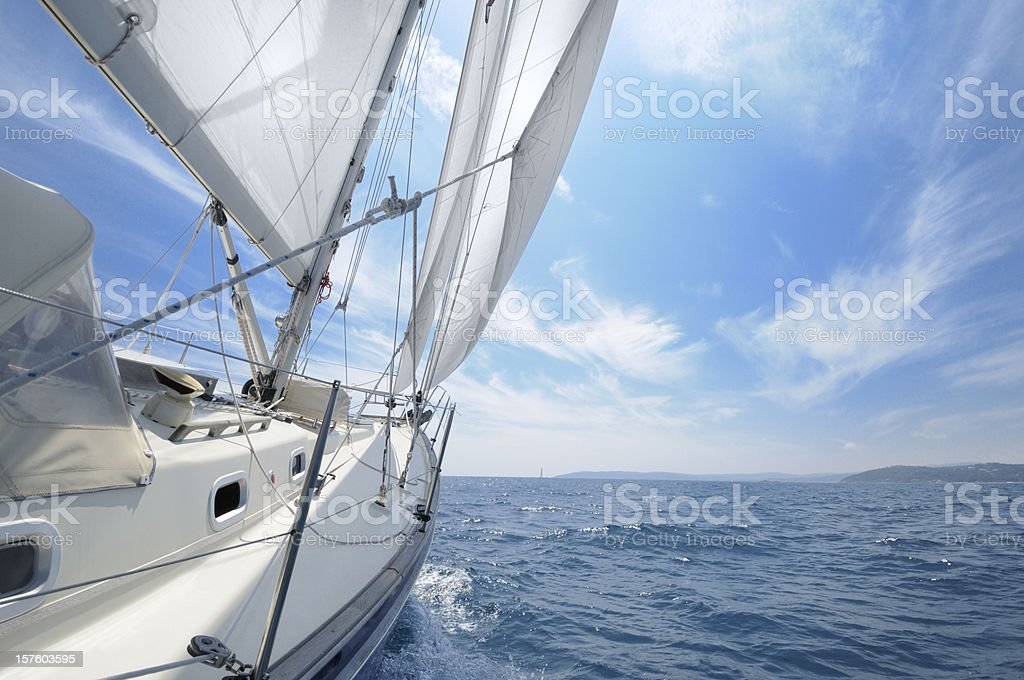 Sailing towards the horizon in open sea stock photo