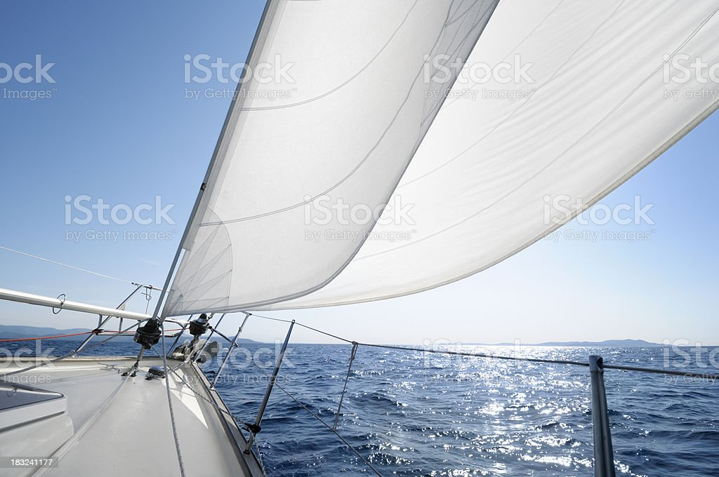 Sailing towards the horizon on a sunny day royalty-free stock photo