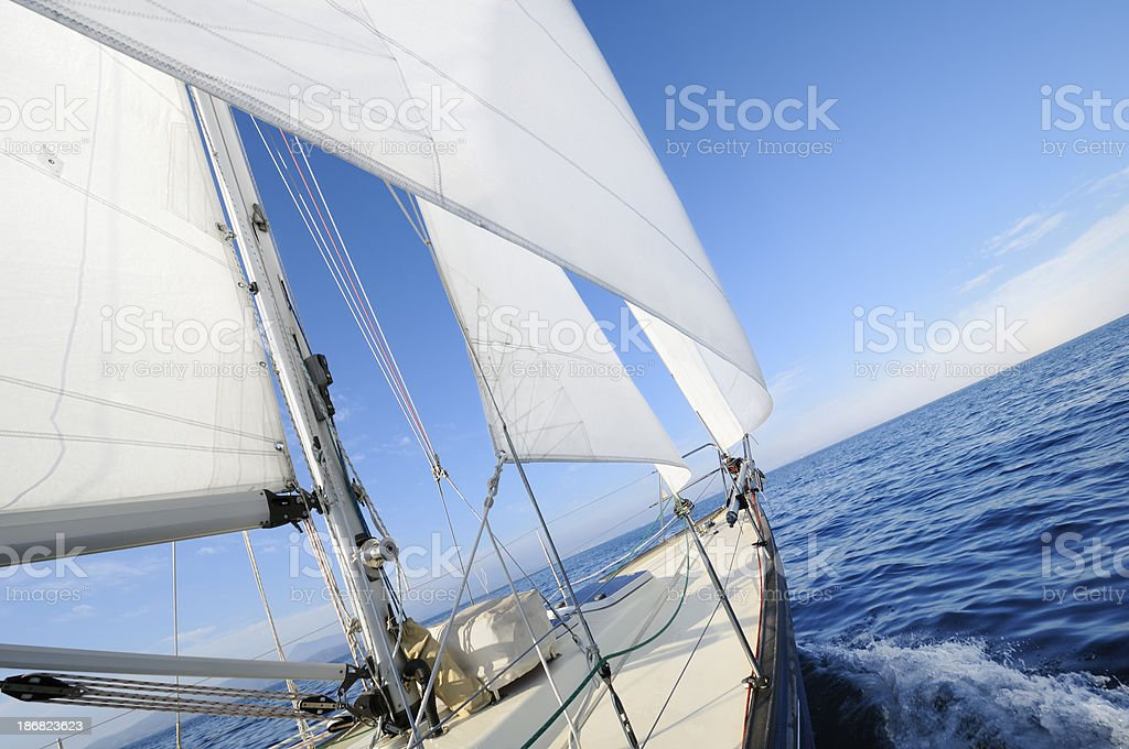 Sailing towards the horizon stock photo