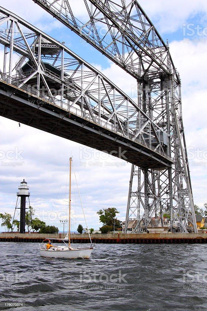 Sailing under the lift bridge stock photo