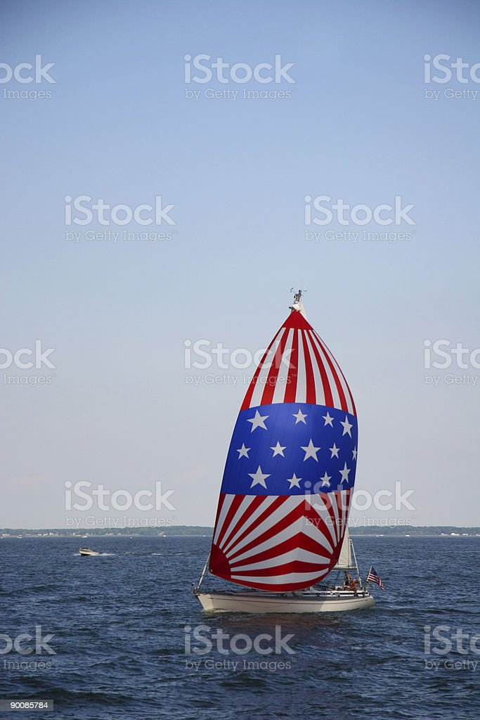 Sailing with patriotism royalty-free stock photo
