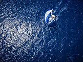 Sailing with sailboat, view from drone