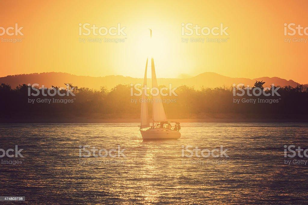 Sailing yacht against sunset royalty-free stock photo