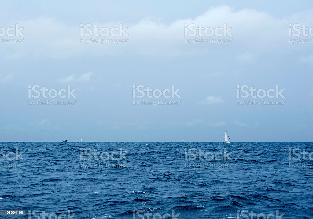 Sailing Yacht and fishing ship in the Storm stock photo